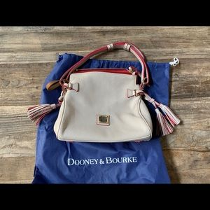Dooney and Bourke beige leather bag with tassles